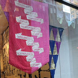 banners and flags in a storefront window