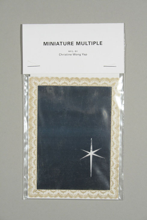 Untitled (Lens Flare, Tiny Mirror) (Miniature Multiple)</em>,           2007, mirrored paper, printed paper, vellum, laser-printed brochure,         plastic bag and laser-printed hangtag, 3.5 x 5 inches / 9 x 13 cm, edition           of 170