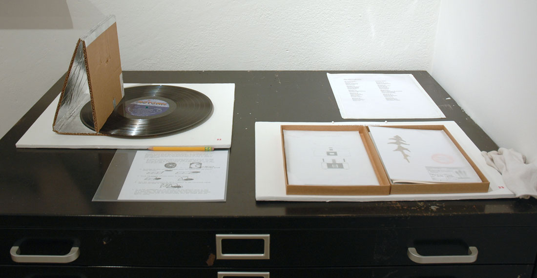 N. Sean Glover, Record Player in an Envelope, 2009, media mixed, roughly 8×11 inches / 203×279 mm / Pest (Rebecca Chesney, Robina Llewellyn & Elaine Speight), Pest Limited Edition Box Set, 2009, Media Mixed, 6.7×9.25×0.8 inches / 17×23.5×2 cm