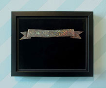 Banner #1, 2010, color laser on acetate, holographic gift bag, mat board, frame, 12 x 9 inches / 30 x 23 cm