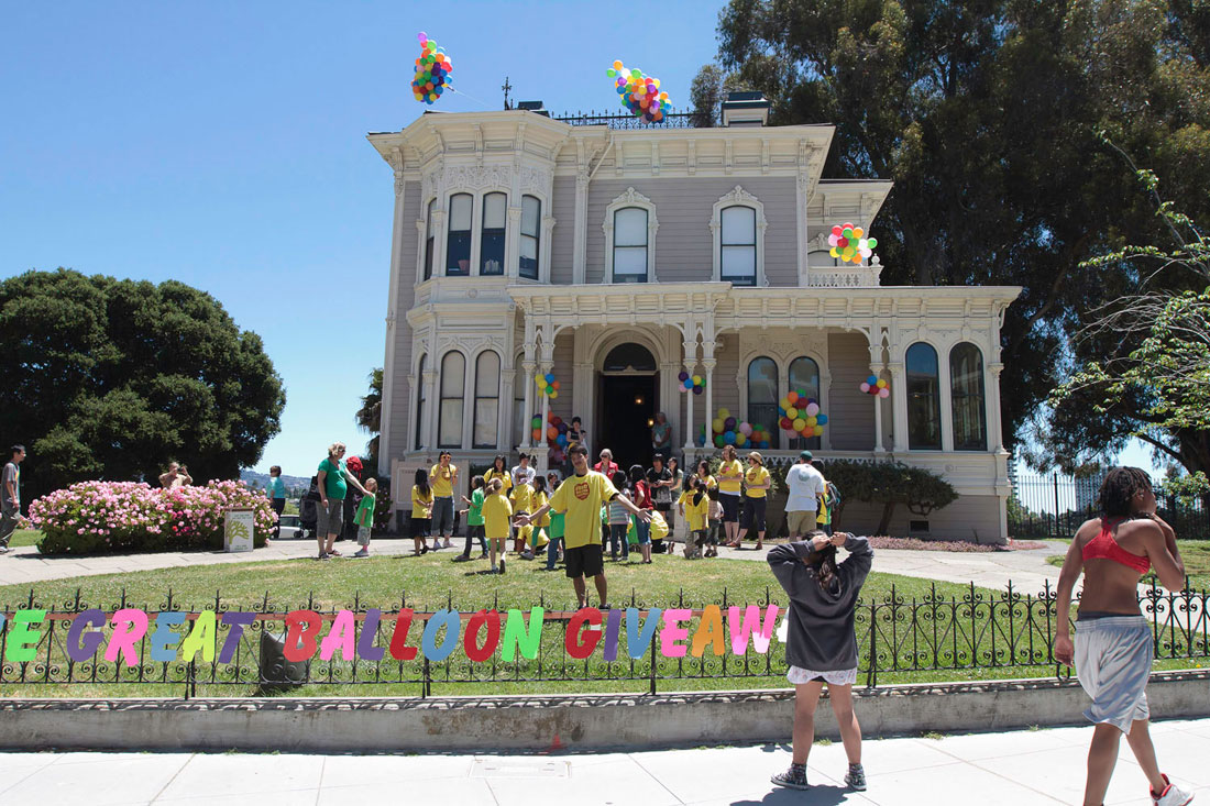 Christine Wong Yap with children from the City of Oakland's   Lincoln Square Recreation Center, The Great Balloon Giveaway, 2010,   public project and social sculpture: 1,000 helium-filled balloons, Camron-Stanford   House, Lake Merritt, Oakland, CA. Mills Art Museum's Here   and Now, curated by Christian L. Frock presents Invisible Venue.