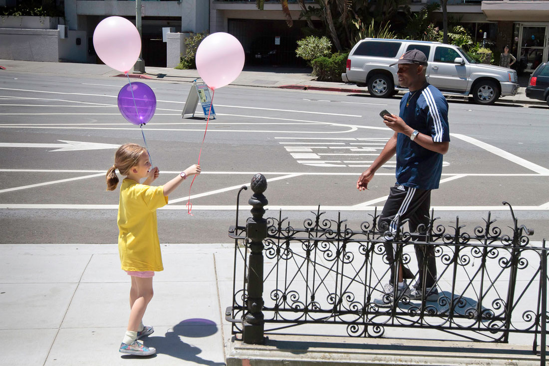 Volunteers distributed balloons in front of the house, facing downtown Oakland.