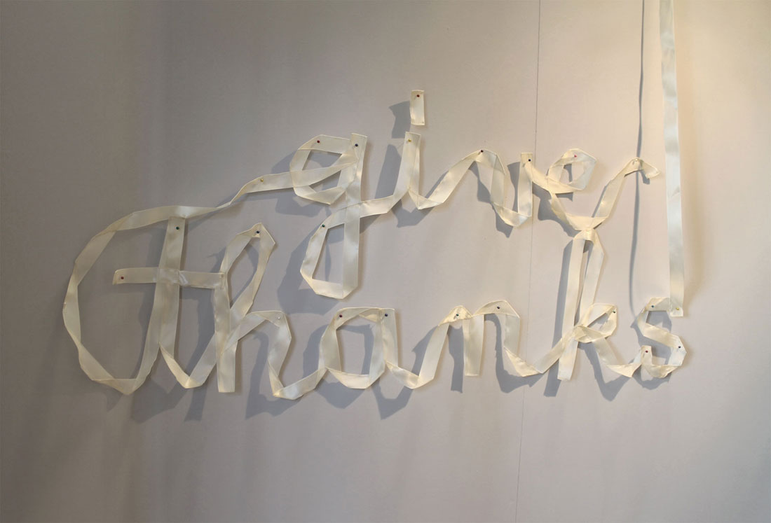 detail. text: give thanks spelled in ribbon