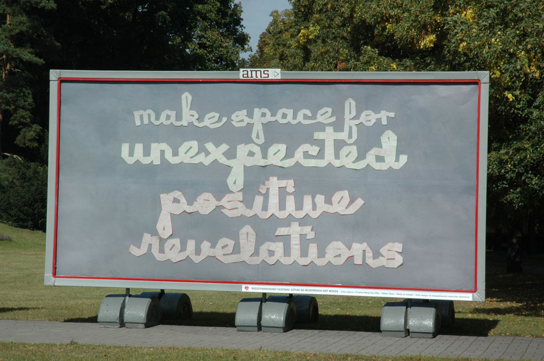 Art Moves Festival billboard, September 2012, Toruń, Poland. text: make space for unexpected positive revelations