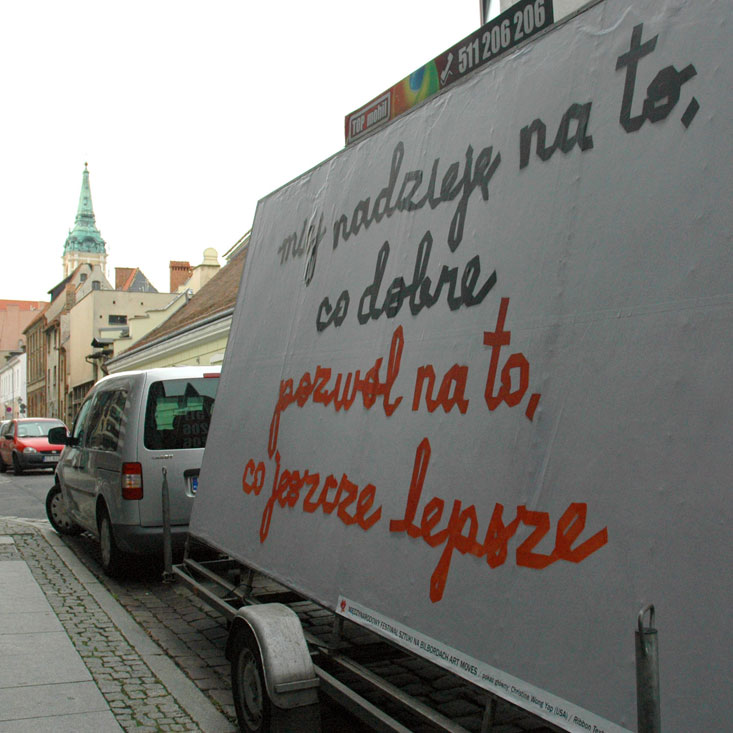 Art Moves Festival billboard, September 2012, Toruń, Poland.text: miej nadzieję na to, co dobre, pozwól na to, co jeszcze lepsze (hope for good, allow for even better)