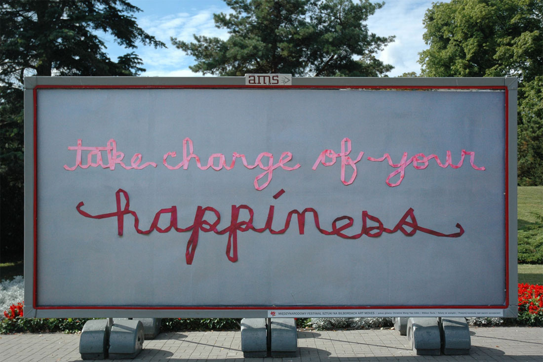 Art Moves Festival billboard. text: take charge of your happiness
