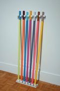 an array of brightly colored walking sticks