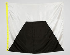 white flag that shows a black pyramid with the top cut off.