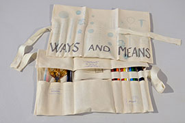 a letterpress printed canvas tool roll with pencils and art supplies