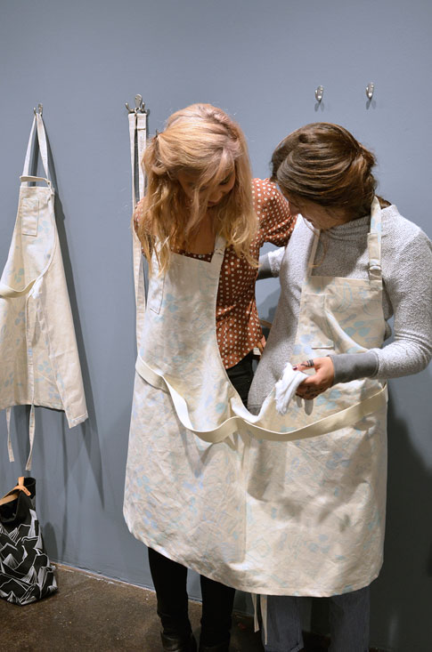 Visitors wearing the double apron