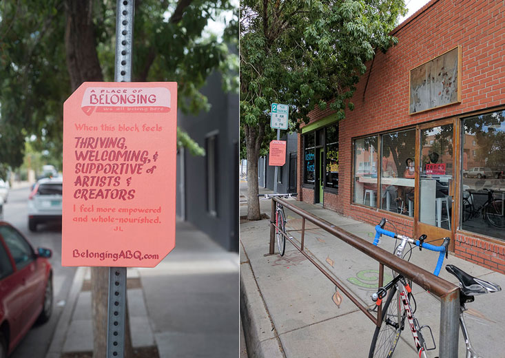 image of belonging sign #1 at 2nd Street SW, in front of a coffee house and bike rack. Text of the sign: 'A Place of Belonging #1, we all belong here. Thriving, welcoming, and supportive of artists and creators. I feel more empowered and whole-nourished. JL. BelongingABQ.com'