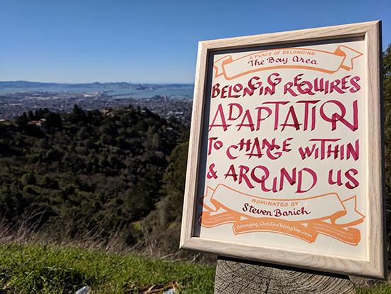 A certificate at a scenic outlook in the Oakland/Berkeley Hills overlooking the Bay Bridge in the distance